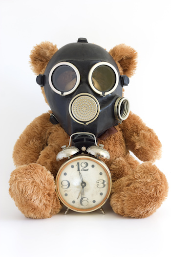 The Nursery toy, gas mask, old watch on white background.