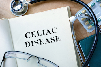 Celiac Disease concept. Book with stethoscope and pills.